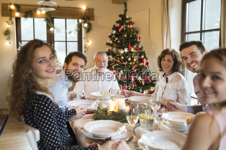 happy family at christmas dinner table
