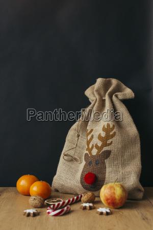 gunny bag fruits candy cane walnuts