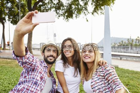three friends taking a selfie in