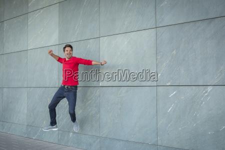 active man jumping for joy cheering