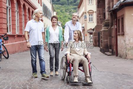 germany heidelberg senior friends with woman