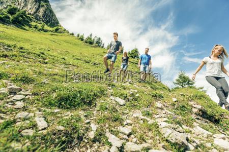 germany bavaria pfronten family hiking on