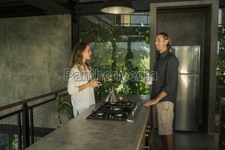 couple having breakfast and smiling in