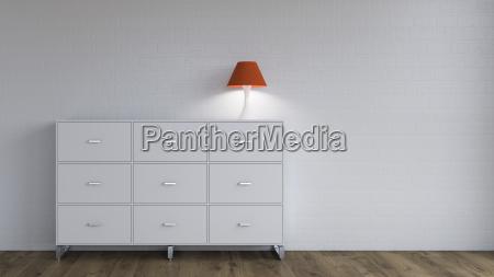 burning lamp on sideboard