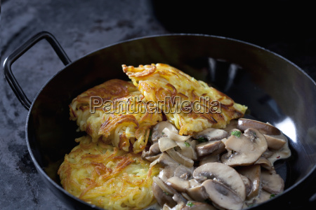 pan of potato rostis with champignons