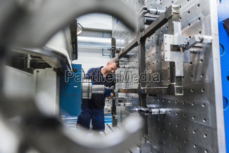 man working on machine in industrial