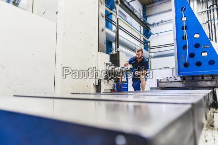 man working on machine in industrial