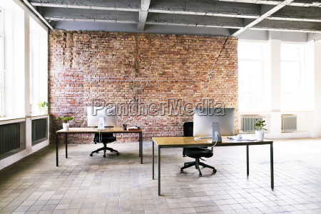 coworking space with brick wall in