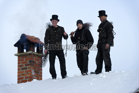 group picture of three chimney sweeps