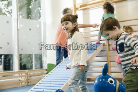 happy children in gym room in