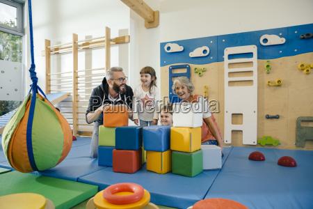happy children and teachers in gym