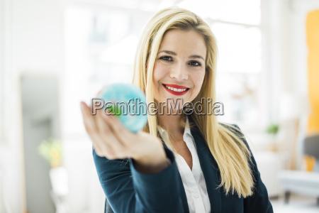 portrait of smiling businesswoman holding mini