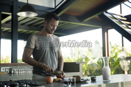 man preparing breakdast with milk bread