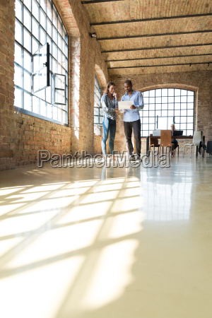 two young entrepreneurs viewing loft for