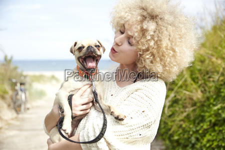 portrait of young woman holding dog