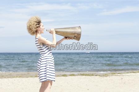 young woman with megaphone on the