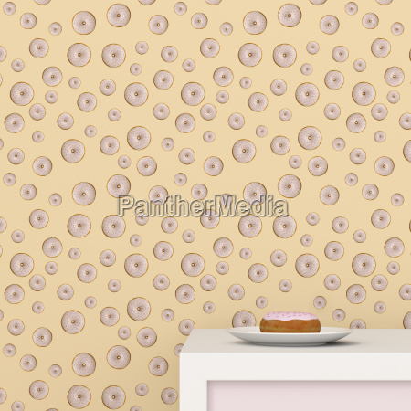 plate with doughnut on cup board