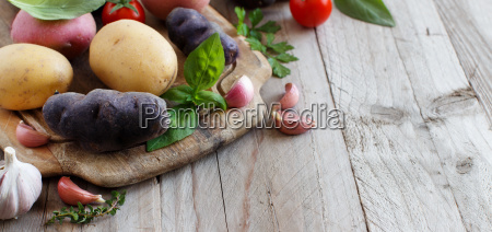 raw potatoes and vegetables