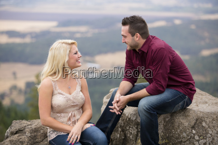 portrait of couple talking and sitting
