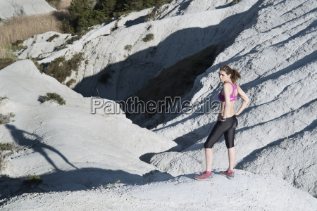 woman standing in arid mountains gurb