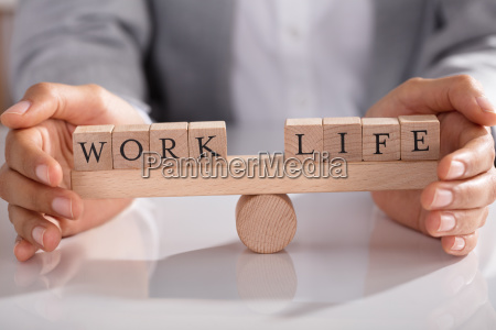 businessperson protecting life and work on