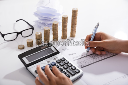accountant calculating tax using calculator on