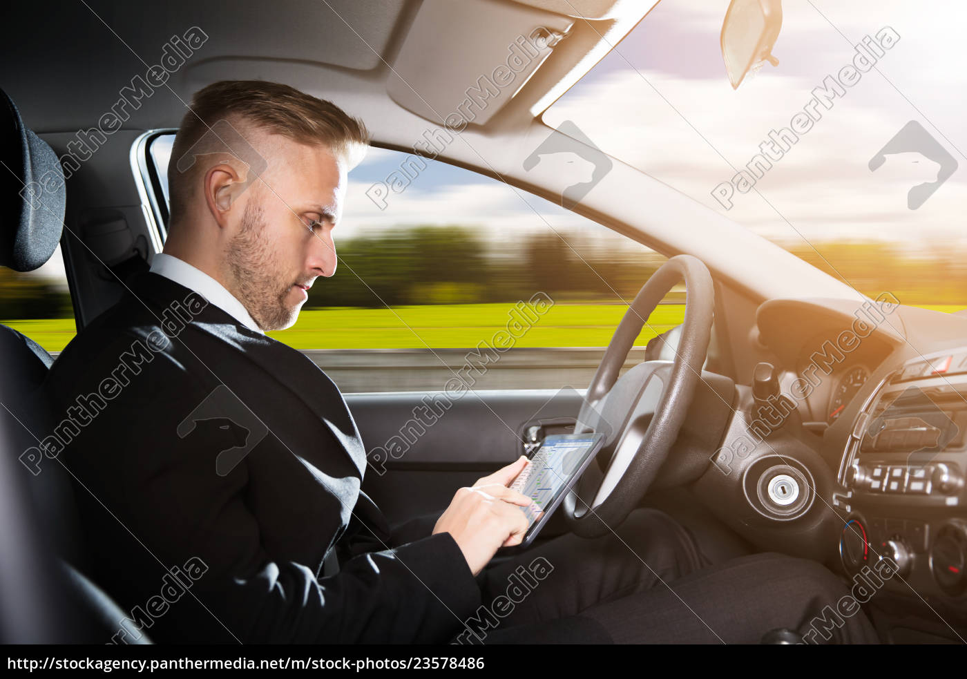 businessman, sitting, inside, self, driving, car - 23578486