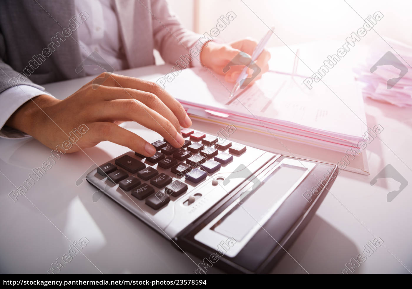 businessperson, calculating, bills, in, office - 23578594