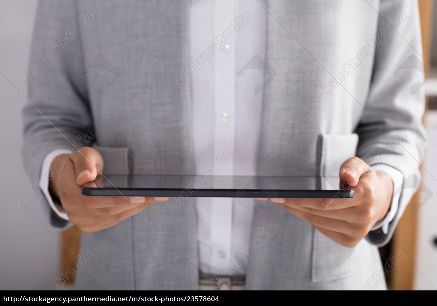 businessperson, holding, digital, tablet - 23578604