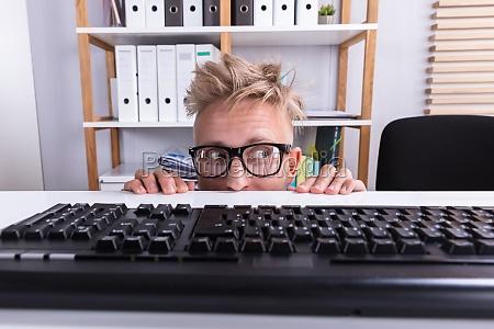 funny, businessman, hiding, behind, desk - 23578562