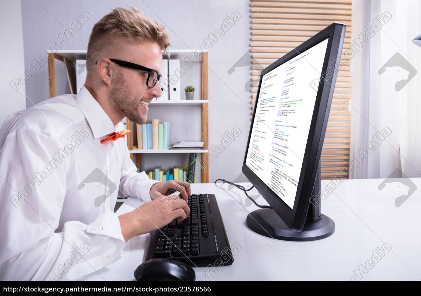 funny, businessman, working, on, computer - 23578566