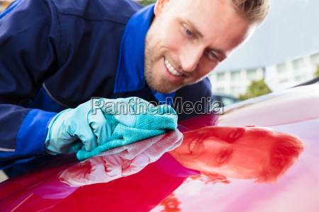 happy, male, worker, cleaning, red, car - 23578458