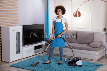 janitor, cleaning, carpet, with, vacuum, cleaner - 23578380