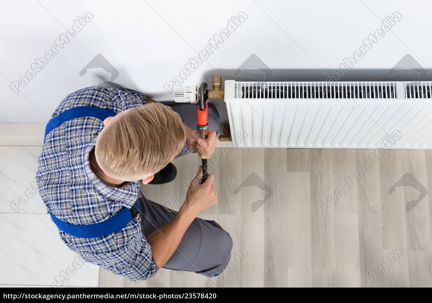 male, plumber, fixing, thermostat, using, wrench - 23578420