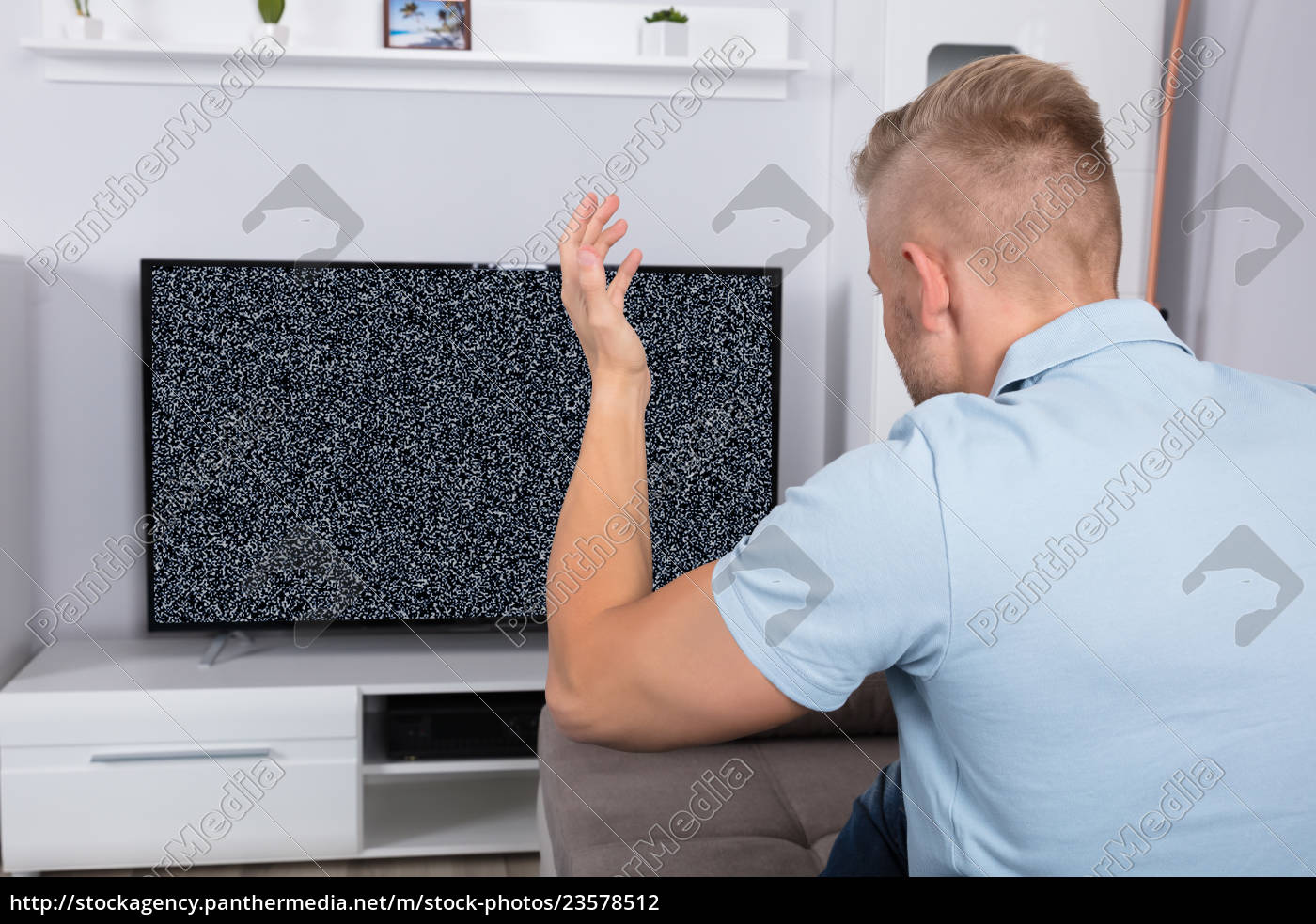 man, in, front, of, television, with - 23578512