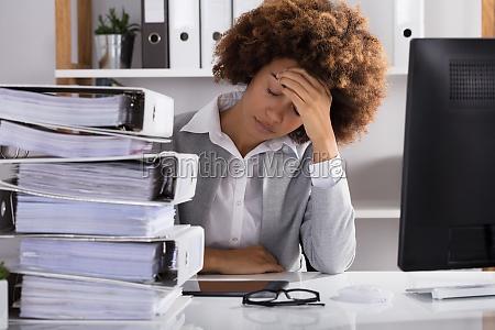 stressful, businesswoman, sitting, in, office - 23578582