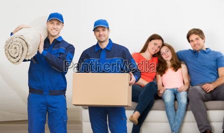 two, mover, men, carrying, cardboard, box - 23578394