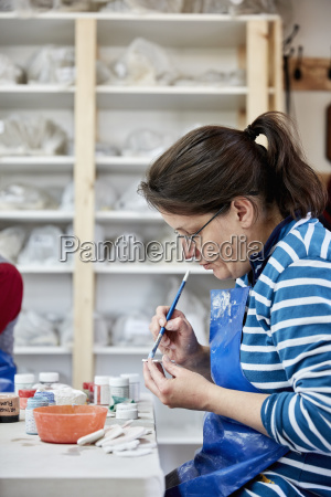 a woman using a handtool to