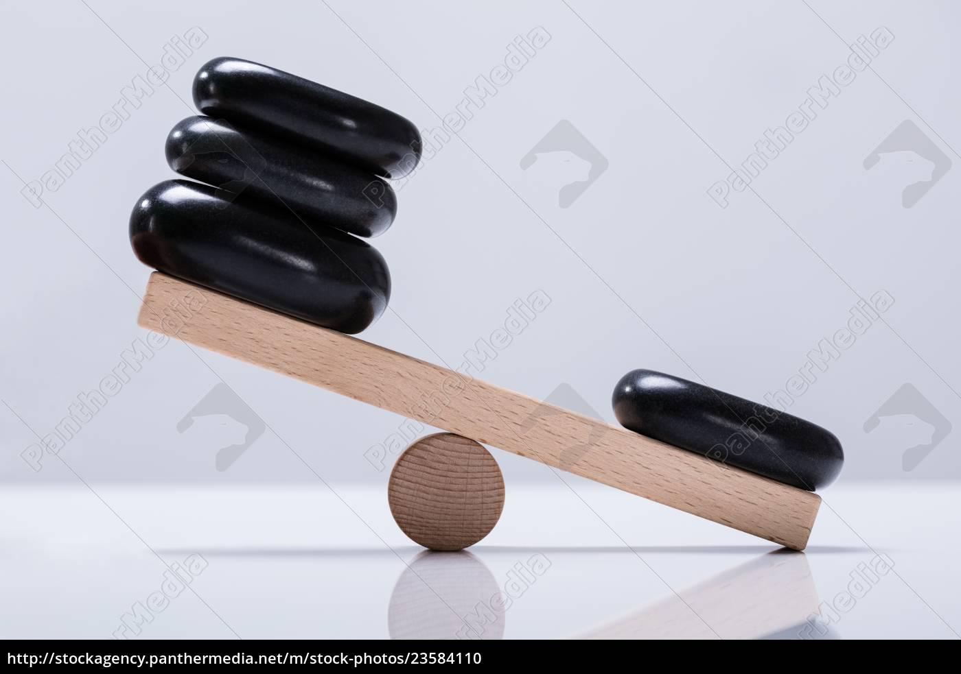 black, stones, balancing, on, seesaw - 23584110