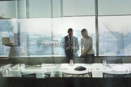 businessman and businesswoman working using digital
