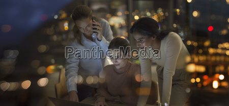businesswomen working late at laptop in