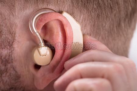 man wearing hearing aid
