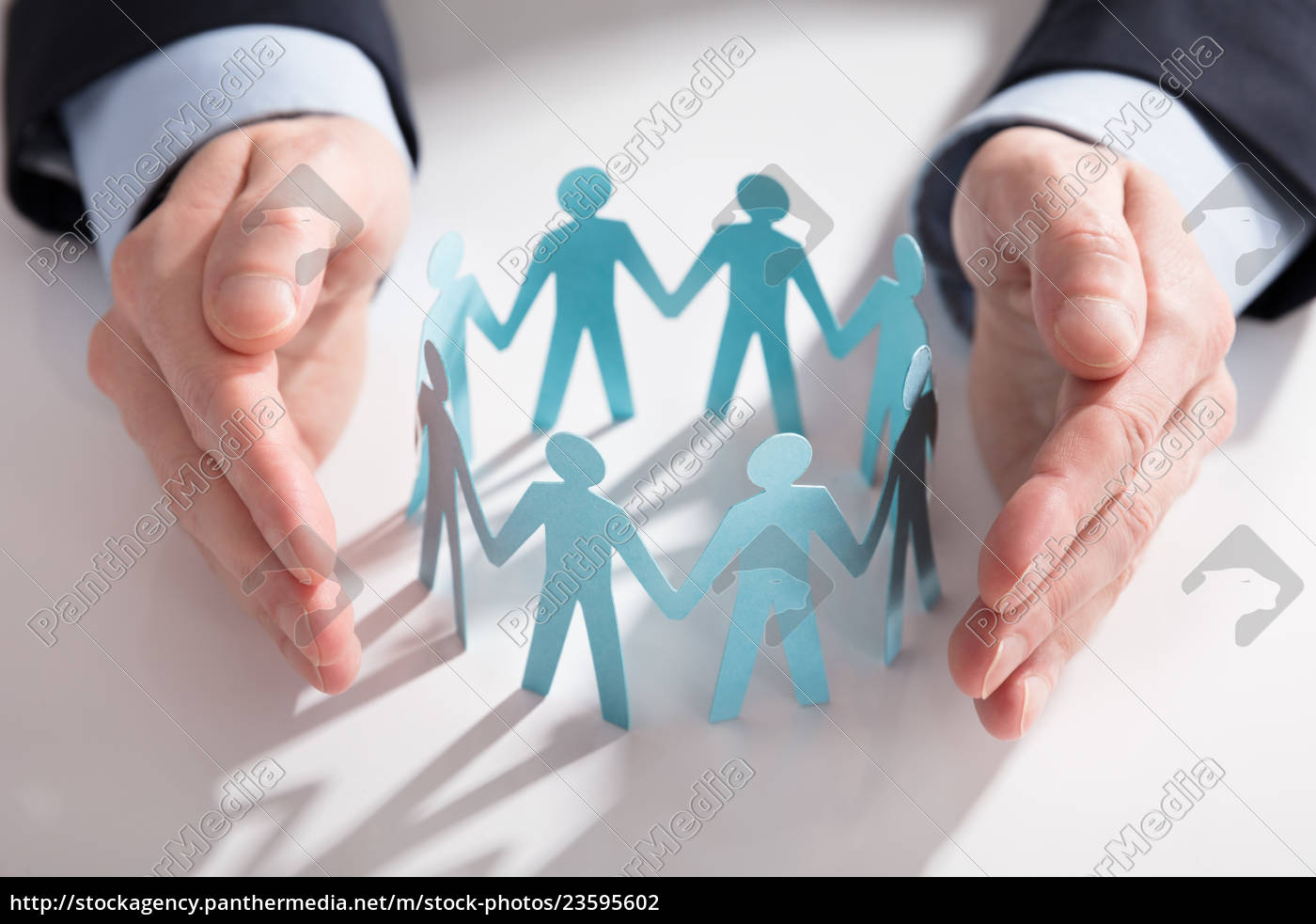businessperson's, hand, protecting, paper, cut, out - 23595602