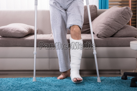 man, with, broken, leg, getting, up - 23595322
