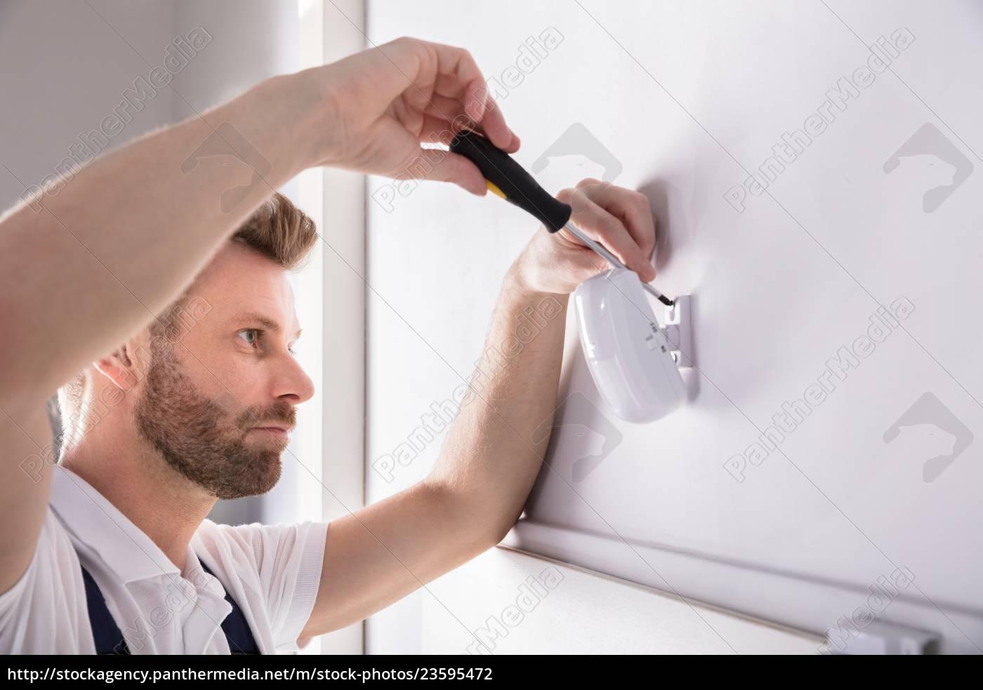 technician, installing, security, system, door, sensor - 23595472
