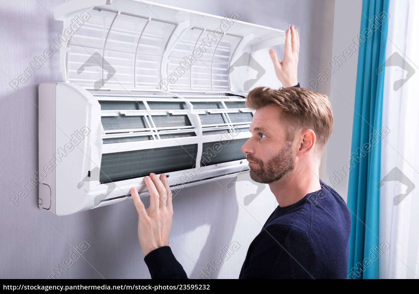 young, man, checking, air, conditioner - 23595232