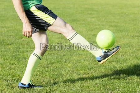 soccer player shooting ball