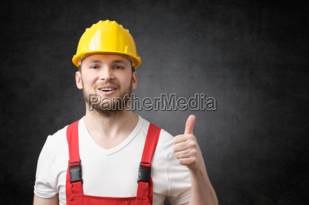 happy worker showing thumbs up sign