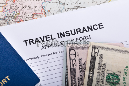 currency notes and passport on insurance