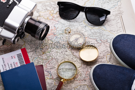 boarding pass ticket passport and camera